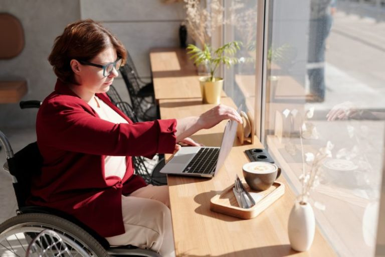 Disabled woman on laptop